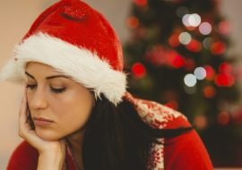 Festive brunette feeling sad at christmas